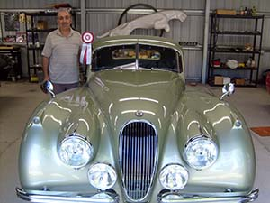 Rafi with Best Of Show Winner ribbon 1952 XK120 Coupe